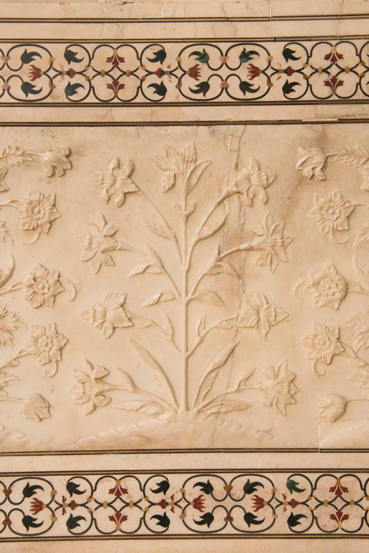Stukkatur i marmoren på Taj Mahal
